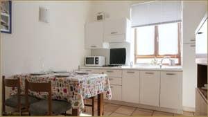 Le Salon-Salle à Manger Cuisine de l'appartement Laguna Crose