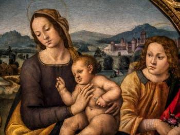 Lorenzo di Credi, Vierge à l'enfant, Saint-jean et les anges, 1500-1520, à la Galerie des Offices, les Uffizi à Florence en Italie