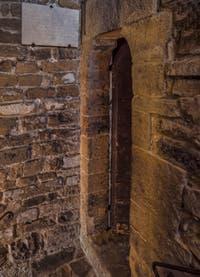 La porte d'entrée de la prison de la Tour Arnolfo du Palazzo Vecchio à Florence en Italie