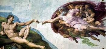 La fresque de la création d'Adam au plafond de la chapelle Sixtine par Michel-Ange au Vatican à Rome