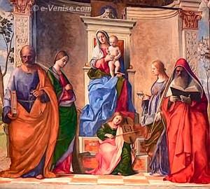 Giovanni Bellini. Au centre la Vierge et l'Ange musicien